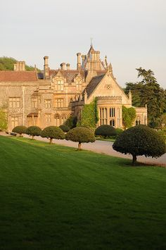 a dramatic golden view of Tyntesfield House - Bristol, England