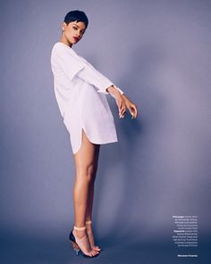 Rihanna wears an oversized white dress shirt in ELLE UK April 2013, shot by Mariano Vivanco.