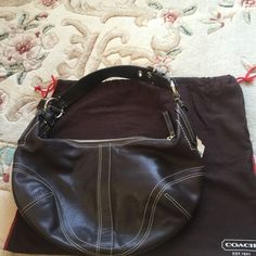 """Authentic Coach  Leather Hobo Shoulder Bag Gorgeous NWOT Coach chocolate brown leather hobo shoulder bag with Buckle strap  one zippered interior pocket and two open pockets on opposite side of interior. Bag depth 6"""" bag length 20"""" adjustable strap bag height 7"""" complete with Coach dust bag Coach Bags Hobos"""