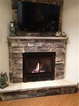 corner fireplace with tv above