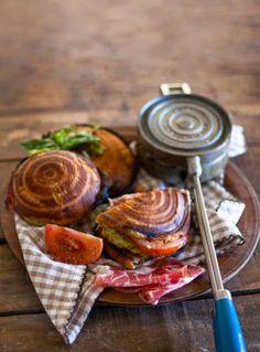 tomato, basil pesto, mozzarella balls and if so desired, you can add cold meats such as salami, prosciutto etc.  Spread basil pesto over the ciabatta bread
