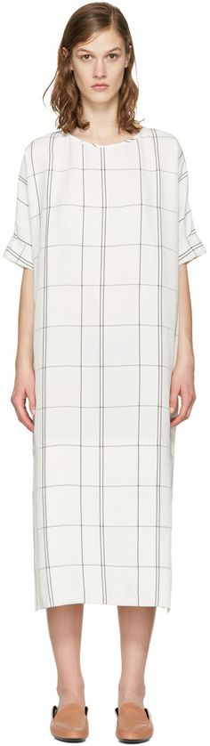 Short-sleeve woven dress featuring windowpane check print in grey throughout. Oversized fit. Crewneck collar. Rolled cuffs. Vent at side seams. Partially lined. Tonal stitching.