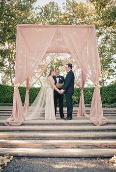 Wedding Altar with Pink Draped Fabric   Brides.com