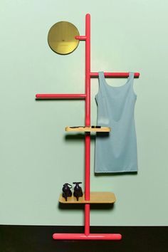 abstract valet stand for tomorrow's outfit  Camerino Valet Stand in Strawberry Red, design Matteo Fogale and Joscha Brose.