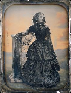 thecivilwarparlor:  Woman in Black Taffeta Dress and Lace Shawl-Pre-Civil War Women's dress in to the Civil War,Women loved the idea of a tiny waist with yards of material in the skirt. The corset was being worn along with a metal hoop and crinoline to make the desired effect of a tiny waist with a huge skirt.  Albert Sands Southworth (American, West Fairlee, Vermont 1811–1894 Charlestown, Massachusetts)