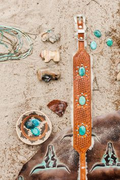 Real turquoise and leather dog collar. Made with genuine turquoise and stamped by hand with a basket weave and scallop design. Shearling is added for comfort.