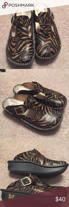 Alegria tiger print shoes Beautiful excellent condition tiger print Alegria shoes, very comfortable, just a few small scuffs on toe as seen in pics. Alegria Shoes