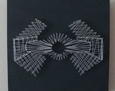 Nail & String art in the style of the Death Star, Millennium Falcon, and Darth Vaders Tie Fighter. The artwork was created on our own custom-made 1-1/2 thick wood canvases which are painted with an imperial matte black paint to contrast the rebellious light gray string.  Each one can be hung on the wall or it will stand by itself on any flat surface.  Please note that this listing is for ALL THREE pieces of artwork combined into one listing (you get 1 Death Star + 1 Millennium Falcon...
