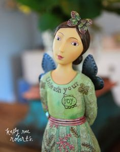 This is our new Unleash Your Joy figure. I love the process of seeing these girls come alive. I especially love the sweet greens and pinks in this one.