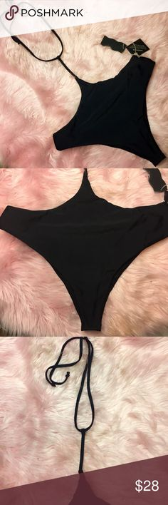 """Nasty gal suspender bikini bottoms Bottom w/ semi cheeky back, and front tie that goes up center, over the belly button, then splits to tie around your neck halter style. Looks great over any bikini top ( I think it'd look best over a bandeau or strapless style) perfect for when you wanna wear a bikini but feel bloated- hides any belly pooching in the water, easily untie&grill down for basking. NWT but just removed hygienic liner- edges got dusty in drawer, seemed more """"hygienic"""" to take…"""
