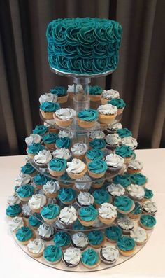 Teal wedding cupcake tier with cutting cake. Made by CupCasions Kelowna. Teal wedding cupcake tier with cutting cake. Made by CupCasions Kelowna. Cupcake Tier, Cupcake Cakes, Cupcake Ideas, 16 Birthday Cake, Sweet 16 Birthday, Birthday Parties, Teal Cupcakes, Wedding Cakes With Cupcakes, Teal Wedding Cakes