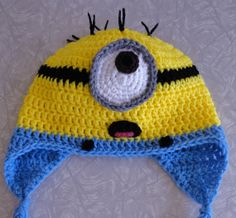 Crochet Hat. MINNION! My mom made one already similar to this for Riley's Birthday. HE LOVED IT! Can't wait for winter for him to wear it with his minion shirt I got him!