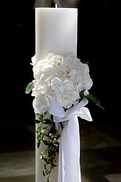 Wedding Candle decorated with fresh white peonies and berries  http://www.aressana.gr/weddings-events-santorini.php