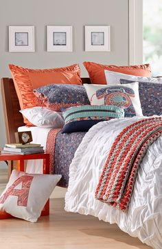 Love the combo of the white duvet with the fun pillows!