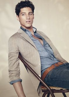 a little dressier. chambray button up shirt, casual neutral blazer, brown leather belt and dark wash jeans.