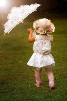 Sweet little girl with umbrella by VoyageVisuelle