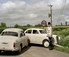 KNITTED CARS!    Guinevere and Knitted Cars, Suffolk, England, 2006, Photography: Tim Walker