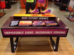 Nike Flyknit Lunar 2 - Impossibly Light. Incredibly Strong. retail table display sports shoe display.