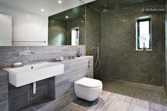 The bathroom is my favorite room. Fancy tiles! (Magazine photo).
