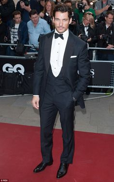 Red carpet pro: David Gandysmouldering in his three-piece suit on Tuesday night