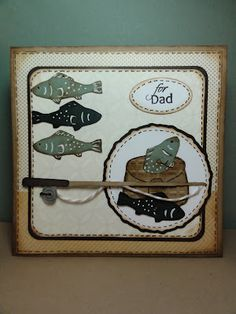 cut the fish, fishing pole, and basket from Everyday Paper Dolls. I did a lot of inking and highlighting on them. The basket is embossed with the Mesh Texture folder then added twine to the pole for the fishing line.