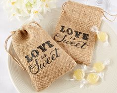 so perfect for a rustic themed wedding! burlap favor bags #wedding #rustic #farm #barn #favors #thankyou http://www.beforetheidos.com/Love-is-Sweet-Burlap-Drawstring-Favor-Bag-Set-p/ka-29037.htm