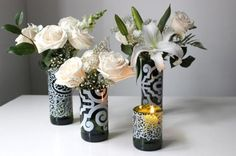 There are so many wine bottle uses and one of them is this. DIY this wine bottle vase and decorate the corner of your home. You can also tuck the cut flowers in the bottle without cutting it.