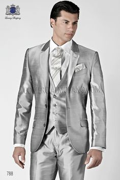 Three piece pearl gray shantung suit with notched lapel and two buttons closure. Flap pockets, ticket pocket and angled buttonholes. Twin vents at back, style 788 Ottavio Nuccio Gala, 2015 Fashion Collection.
