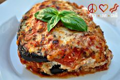 Eggplant Lasagna with Meat Sauce1 Large Eggplant 6 Cups Tomato Meat Sauce 2 Cups Ricotta Cheese 2 Cups Mozzarella Cheese – Shredded 1 Cup Parmesan Cheese – Shredded 8 Small Fresh Basil Leaves – Chopped 1 Tbs. Dried Oregano
