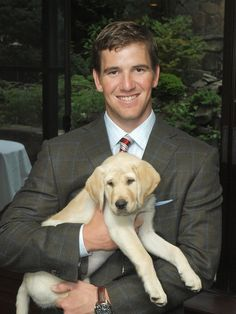 Eli Manning with his pup. #celebrities #dogs the question is...will he bring him to the park to play with all of our doggies? Let's hope so!!!