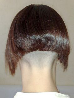 Very short buzzed nape quickly transitioning to a bobbed hairstyle