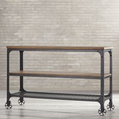 Features: -Finish: Black Sand. -Frame material: Metal. Product Type: -TV Stand. Finish: -Black Sand. Frame Material: -Metal. Design: -Open shelving. Dimensions: -Weight limit shefl: 200. Overa