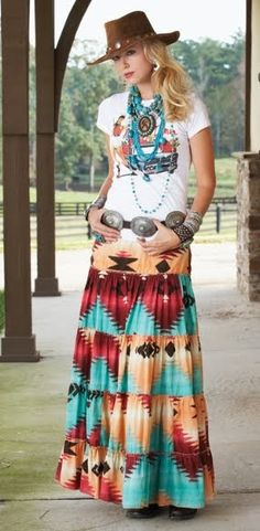 HTML clipboard White T-shirt and colorful skirt with beautiful belt and buffalo nickel hat.