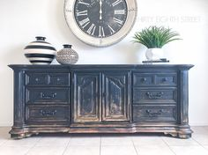 One man's trash is another man's treasure! Carrie from Thirty Eighth Street took an old, discarded dresser and repurposed it into this amazing ombre media cabinet in Liquorice!