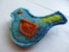 Hand-stitched from scraps of handmade wool felt - every one is unique!   See more from LittleDeb at Etsy, Facebook and Pinterest. Brooches Handmade, Handmade Felt, Sky Shop, Felt Cover, Tiny Bird, My Notebook, Hand Stitching, Wool Felt