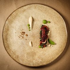 """Sous vide octopus seared with lamb fat, white kidney bean/fennel purée, fennel/parsley purée, green garlic salsa & porcini crumble. Uploaded by…"""