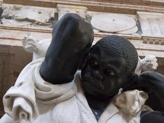 Basilica di Santa Maria Gloriosa dei  Frari - Venice, Italy    Doge Giovanni Pesaro Monument  - Slave in Agony    About to burst from the strain of bearing the weight of the monument this man stares out in agony. Is he resigned to his fate? Does he have any choice? Did he have a life before this one? The architect was Baldassare Longhena. The sculptor was Melchior Barthel.