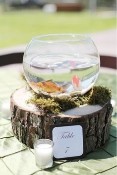 Rustic fishbowl centerpiece. Photo by Feather & Twine Photography. www.wedsociety.com #wedding #centerpiece