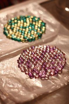 Melted pony bead art.   Ornaments, jewelry, decor?