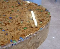 Brown concrete countertop with blue and green glass