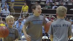 Ball-Boy hits 3 half-court shots in a row crowd goes ecstatic