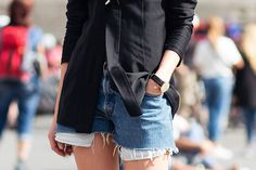 Black shirt, denim shorts, heeled sandals