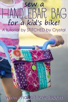 Sew a handlebar bag for your kid's bike! This tutorial shows you how to sew and easy to make bag snaps right on their bicycle handlebars and is great for carrying toys, water bottles, or found treasures.