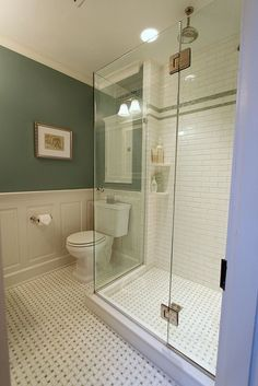 lovely shower, vintage feel bathroom - like the wainscotting, the floors (though again, I prefer plain white with gry grout in this pattern to the grey and white combo tile)  a fun line of colour up towards the top of shower repeats the paint colour...not sure I'd go there...but nice here.