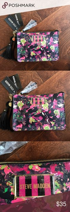 Steve Madden floral print  Wristlet with keychain Great colorful Wristlet for summertime with quite a bit of room to carry all your essentials. Top zip closure keeps everything safe & secure. Inside has one zip pocket and 2 slip pockets.back has a slip pocket with Steve Madden logo . Front also has logo. Steve Madden Bags Clutches & Wristlets