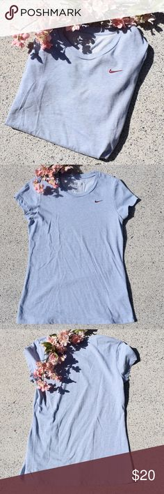 🌸 NWOT Nike Sports Tee NWOT 💘 a beautiful light steel blue color with a maroon embroidered Nike check. the colors alone make this shirt a must have! fitted and a little stretchy. Nike Tops Tees - Short Sleeve