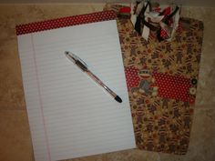 """Beautiful handmade sock monkey clipboard with matching pen and notepad. Clipboard has been mod podged several times and protected with a polyurethane clear satin finish. Coordinating red polka dot paper on reverse side of clipboard. Ribbons have fray ease on the tips to prevent fraying. Perfect for a teacher gift or friend/co worker. Clipboard measures 9X12"""""""
