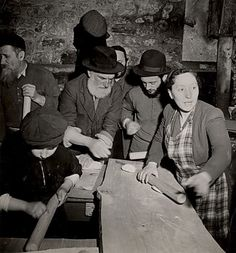 """Holocaust survivors making matzoh, Hénonville Displaced Persons' Camp, Picardy, France"" Photo: Roman Vishniac (1897 - 1990) France, 1947"