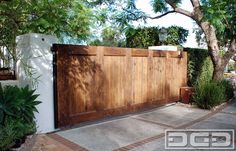 Los Angeles, CA - Custom manufacturing this sliding Spanish driveway gate and paring it with an automatic electric motor made it a wise curb appeal investment for this client. The Spanish style gate added character and beauty to the home but also safety and ease of use.   The rustic sliding gate was fabricated on a galvanized frame, fully concealed with wire-brushed alder wood for structural strength and durability. We are the ...