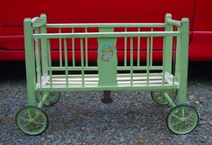 1920's Doll Crib Deluxe From Sears Catalog; Green With Wheels- Side Lowers.